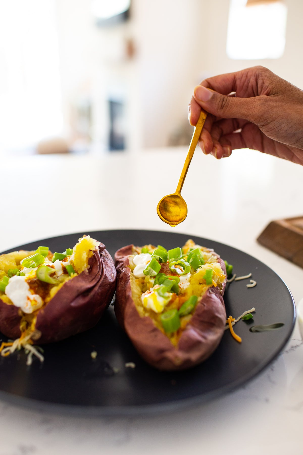 Perfect Messy Baked Potatoes with a Turmeric Oil Drizzle