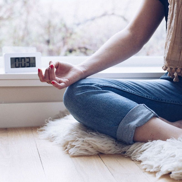 Sitting in meditation with the Awake Mindfulness Clock
