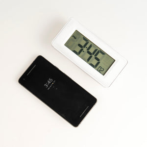 Meditation timer compared with an average-sized smartphone for scale