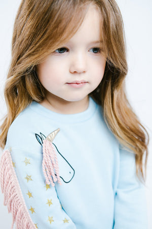 Girl Cute Light Blue Fantasy Terry Crew Neck Sweater with Graphic Unicorn, Pink Yarn Fringe, Gold Star Print Sleeves, Party