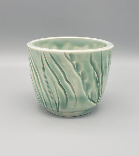Light blue-green carved 3 inch porcelain cup