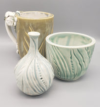 Load image into Gallery viewer, Light blue-green carved 3 inch porcelain cup