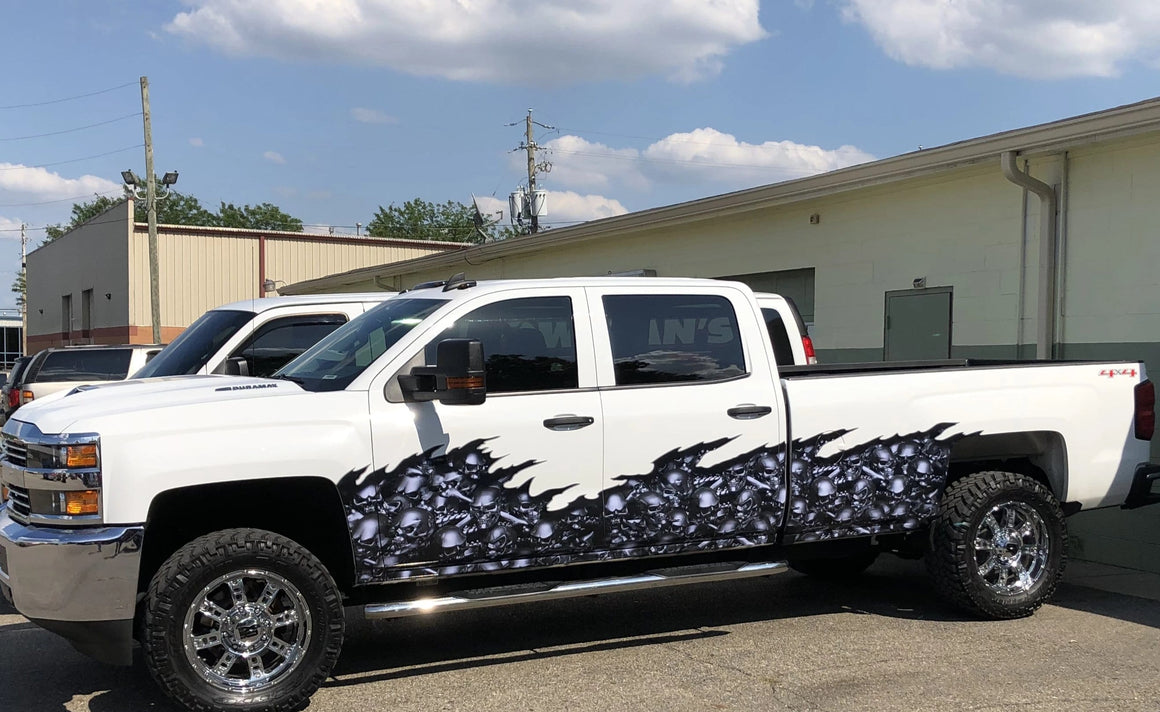 skull wave vinyl half wrap on white chevy pickup