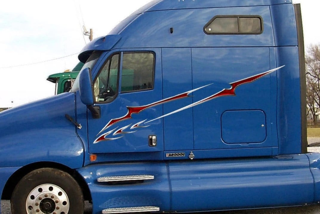 slicer decals on blue semi truck