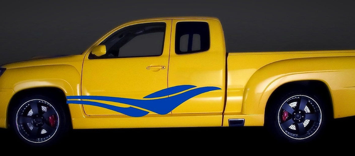 blue vinyl cut decals on side of yellow truck