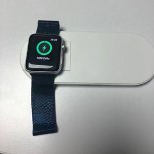 black apple watch getting charged wirelessly