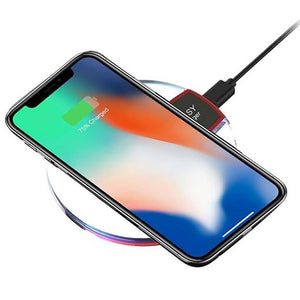 iphone X being charged on a phantom wireless charger