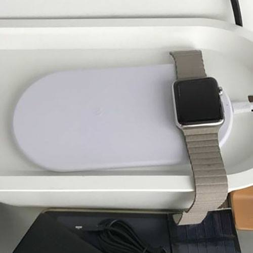 metal apple watch getting charged wirelessly