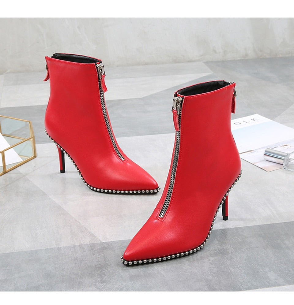 Red heeled ankle boots with zippers