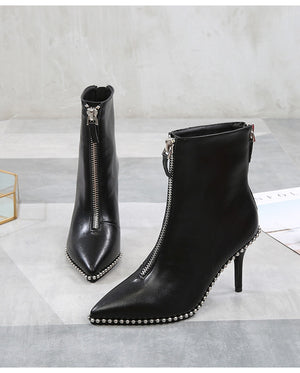 Black heeled ankle boots with zippers