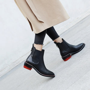Black low heeled leather ankle boots