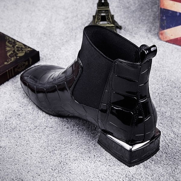 Black patent leather flat ankle boots
