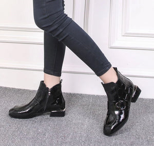Black low heeled patent faux-leather booties