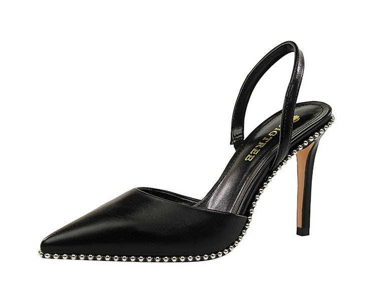 Black sued beads-embellished slingback pumps