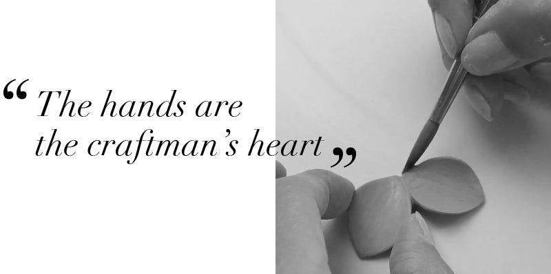 The hands are the craftman's heart. Handmade porcelain jewelry. Details achieved with a brush.