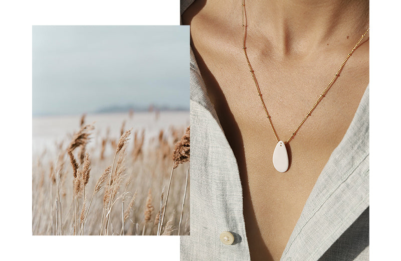 Two images aside: 1. delight wild field near the beach. 2. woman portrait wearing a beautiful and exclusive design necklace. Romantic vibes.