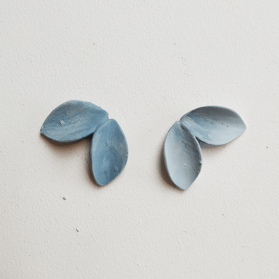 Handmade sculpted strong blue porcelain earrings. Petals shape.