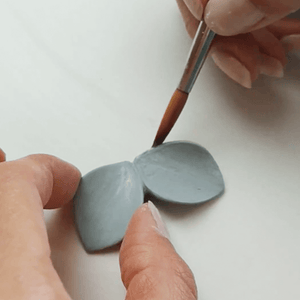 Soft blue clay piece that is turned into jewels with great skill. Handmade jewel made with love.