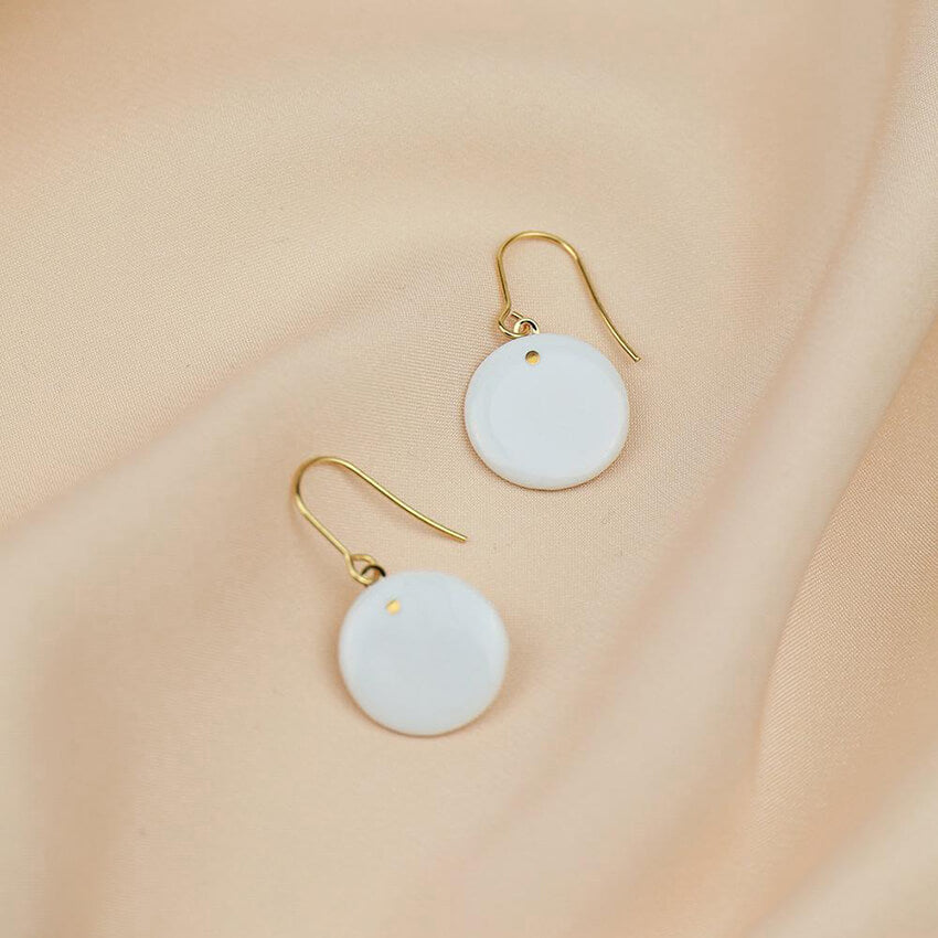 Dangle earrings with minimal style. White porcelain earrings. Statement jewels for any outfit.