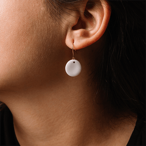 Beautiful detail of white porcelain earrings. Classic porcelain earrings. Unique gift for her.