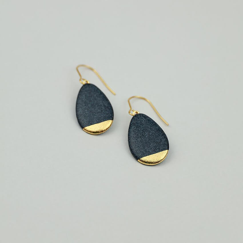 Black porcelain earrings covered with matte black glaze. Dangle earrings. Statement jewels.