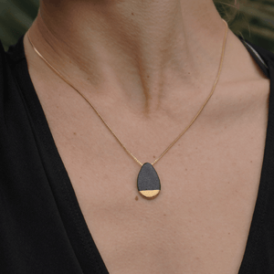 Black porcelain necklace covered in a matte glazed layer. 24k gold luster. Black pendant for her.
