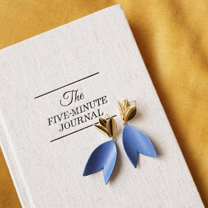 Blue porcelain earrings and a book. Handmade jewelry from Portugal. Handmade with love.