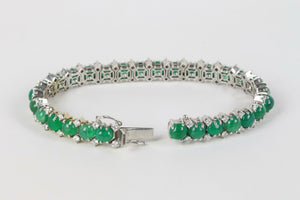 Vibrant 28 Carat Cabochon Emerald and 2.3 Carat Diamond 18K Gold Bracelet - alpha-omega-jewelry