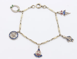 French Art Deco Platinum and 18K Gold Diamond and Sapphire Clown Horseshoe Boat Charm Bracelet