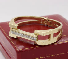 Load image into Gallery viewer, Heavy 1970s La Triomphe 1.75 Carat Diamond and 14K Gold Bangle Bracelet - alpha-omega-jewelry