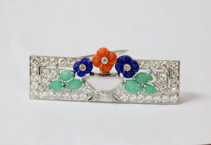 Art Deco 3.7 Carat Diamond Flower Basket Brooch with Carved Rock Crystal, Lapis, and Coral