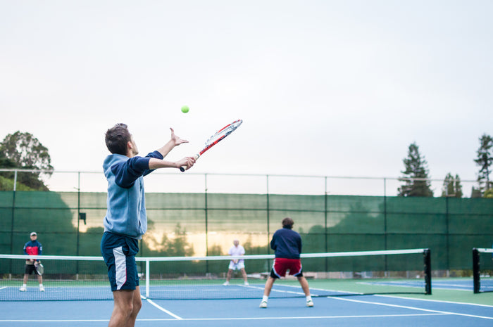 Group of men playing tennis