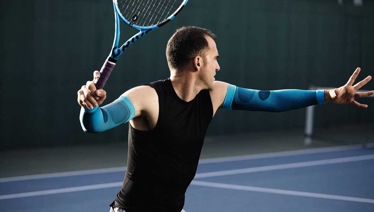 Man playing tennis wear compression sleeves for sports recovery
