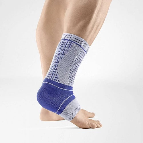 Ankle support in a colour combination of blue and grey and being worn on the right ankle. It is considered as one of Bauerfeind Australia's best recovery supports, the AchilloTrain Pro Ankle Support.
