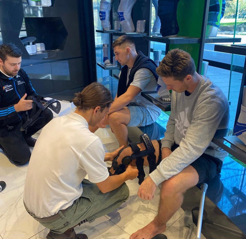 Roosters NRL players being sized for a Bauerfeind knee brace after suffering ACL injuries