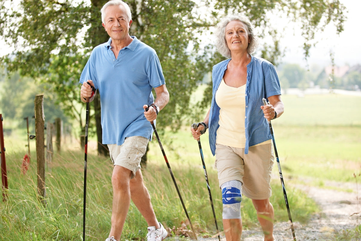 Man and woman hiking with woman wearing knee brace