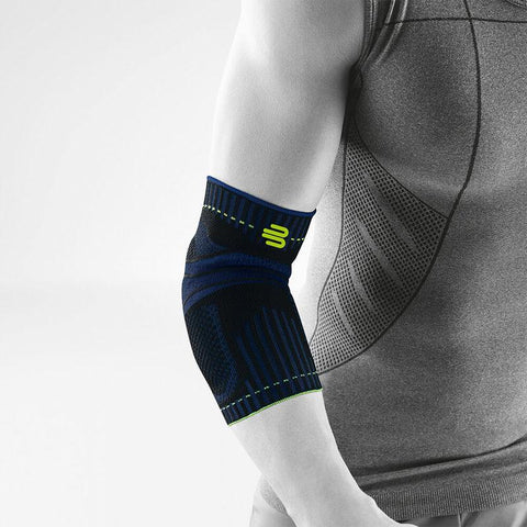 Elbow brace/support having a colour combination of blue, black and green, is wore on right elbow. With the logo of Bauerfeind that is consider as one of their best elbow compression sleeves which is named as Sports Elbow Support.