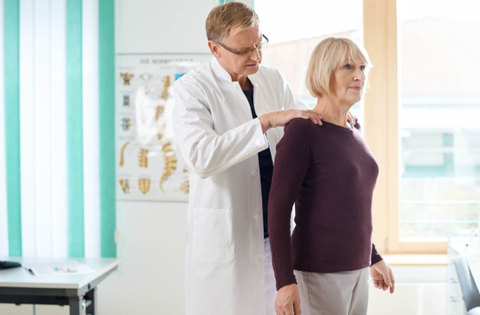 Doctor assessing patient for osteoporosis