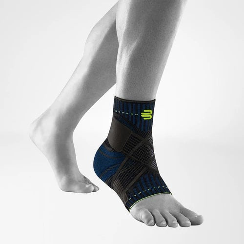 Soccer ankle support/brace in a colour combination of blue and black with the  logo of Bauerfeind Australia and being worn on the right ankle. It is considered one of the best sports ankle supports.