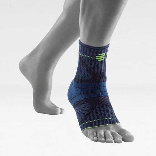 Soccer ankle support/brace in a colour combination of blue and black with the logo of Bauerfeind Australia and being worn on the right ankle. It is considered one of the best Sports Ankle Support Dynamic.