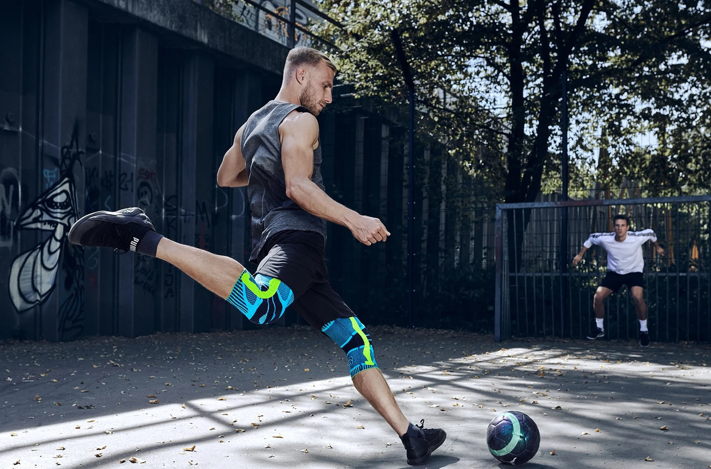 Men playing futsal wearing knee braces and is one of the sports braces and supports made by Bauerfeind.