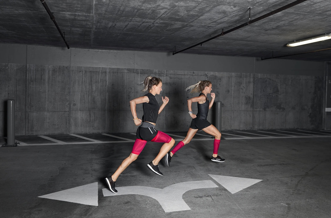 2 women running/jogging and wearing leg braces and is one of the sports compressions made by Bauerfeind.