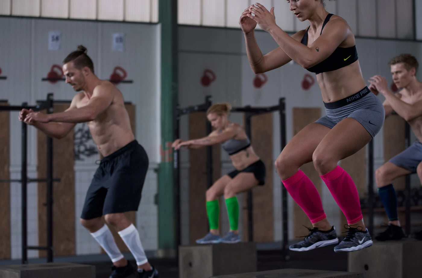 Group of persons doing a Crossfit and all are wearing leg sports support collections made by Bauerfeind.