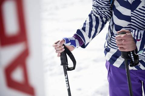 Person in ski gear wearing a wrist and hand support