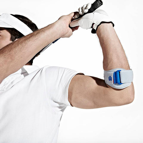 Person playing golf wearing Bauerfeind Sports EpiPoint elbow strap (in white) to assist with tendon pain from Golfer's Elbow