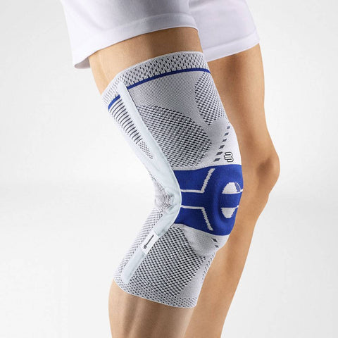 Knee support having a colour combination of blue and gray, is wore on a right knee. With the logo of Bauerfeind that is consider as one of their best knee braces for ACL instability which is named as GenuTrain P3 Knee Brace.
