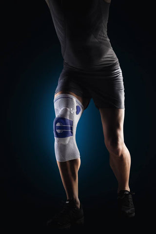 Action shot of person wearing Bauerfeind GenuTrain A3 knee brace to allow for a safe range of kneecap movement to support healing of the patellar tendon