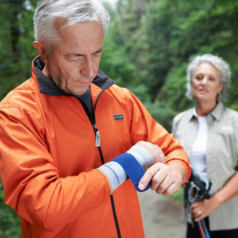 Man wearing a ManuTrain wrist support while out walking with woman