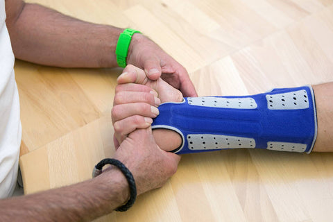 Ddiagnosing arthritis in the wrist with patient wearing Bauerfeind wrist brace
