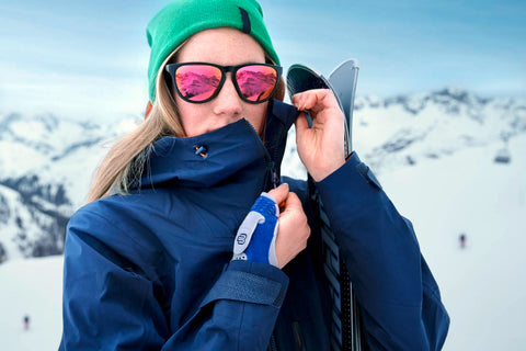 Woman wearing wrist brace while skiing
